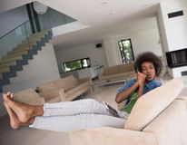 African american woman at home in chair with tablet and head pho Royalty Free Stock Photography