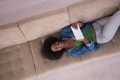 African american woman at home with digital tablet top view Royalty Free Stock Images