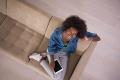 African american woman at home with digital tablet top view Stock Photos