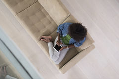 African american woman at home with digital tablet top view Royalty Free Stock Photography
