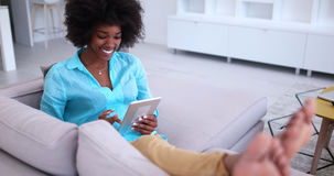 African american woman at home using digital tablet Royalty Free Stock Photo