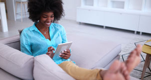 African american woman at home using digital tablet Stock Photography