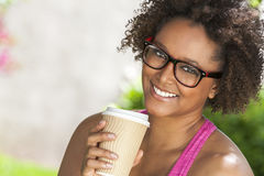 Free African American Woman In Glasses Drinking Coffee Stock Photos - 66686093