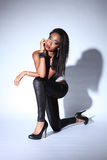 African American Woman In Leggings And Stilettos Royalty Free Stock Image