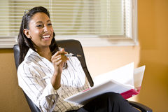 African-American Woman In Office Taking Notes Royalty Free Stock Images