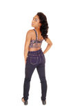 African American woman in jeans from the back. Royalty Free Stock Images