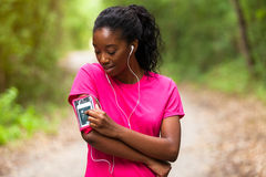 African american woman jogger portrait  - Fitness, people and h Royalty Free Stock Images