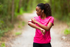 African american woman jogger portrait  - Fitness, people and h Stock Image