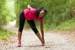 African american woman jogger stretching  - Fitness, people and Royalty Free Stock Image