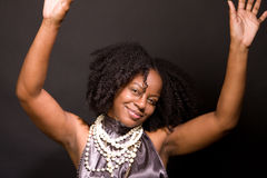 African American woman laughing and dancing. Royalty Free Stock Photos