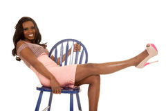 African American woman lean back in blue chair Stock Photography