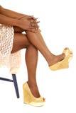 African American woman legs heels sitting Royalty Free Stock Image