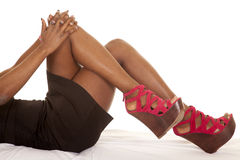African American woman legs lay hands. An African American laying back showing off her legs and shoes Royalty Free Stock Photography