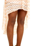 African American woman legs peach skirt close Stock Photography