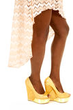 African American woman legs peach skirt side. An African American woman in her heels.  Showing off her legs Stock Photos