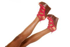 African American woman legs red shoes up Stock Photos