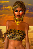 African American Woman in Leopard Print Fashion with Beautiful Cosmetics and Head Scarf. Modern Vogue Pose. A gold abstract background with glowing lights Stock Image