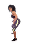 African American woman lifting weight . Stock Photo