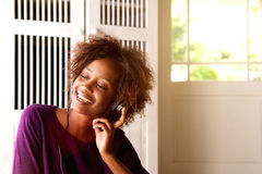 African american woman listening to music on headphones Royalty Free Stock Images