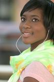African American Woman Listening to Music Outdoors Royalty Free Stock Images