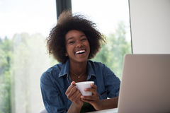 African American woman in the living room Royalty Free Stock Photo