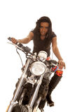African American woman look serious forward motorcycle. An African American with a serious expression on her face Royalty Free Stock Images