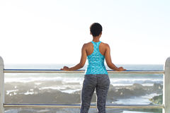 African american woman looking at view of the sea Stock Photos