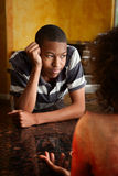 African-American woman and male. Distraught African-American woman and male at home Royalty Free Stock Image