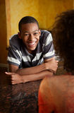 African-American woman and male. Happy African-American woman and male at home Royalty Free Stock Photo