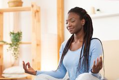 Free African American Woman Meditating In Bed At Home Stock Image - 164228201