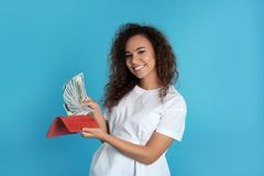 African-American woman with money in wallet royalty free stock image