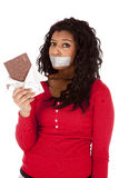 African American woman mouth taped chocolate Royalty Free Stock Photos