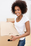 African American woman moving house Stock Images