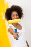 African American woman with a paint roller Stock Photos
