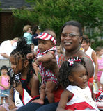 African American Woman in Parade with Children Stock Photo