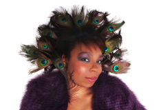 African American woman with Peacock feathers Stock Photo