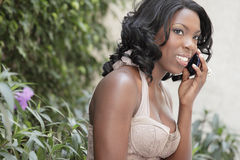 African American woman on the phone Stock Image