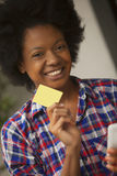 African american woman with phone and credit card royalty free stock image