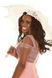 African American woman pink dress umbrella smile Royalty Free Stock Image