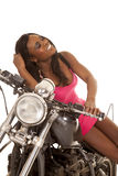 African American woman pink motorcycle sit eyes closed Royalty Free Stock Photography