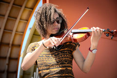 African American woman playing violin outdoors Royalty Free Stock Images