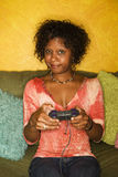 African-American woman plays video game Stock Images