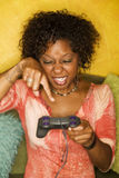 African-American woman plays video game Royalty Free Stock Photos