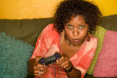 African-American woman plays video game Royalty Free Stock Photo