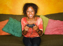 African-American woman plays video game Stock Photos