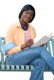 African American Woman Reading a Book, on White Stock Image