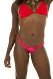 African American woman red bikini body front Royalty Free Stock Photo