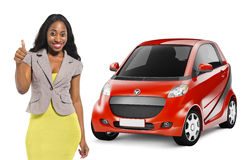 African American Woman by Red Car Stock Images