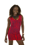 African American Woman Red Pattern Dress Facing Smile Royalty Free Stock Images