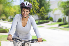 African American Woman Riding Bike Royalty Free Stock Image